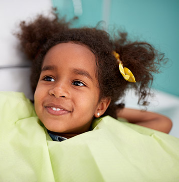 little girl about to have her dental exam